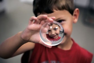 Young boy holding a glass ball