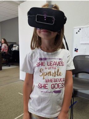 Young girl with a VR-like headset