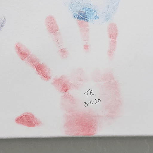 Testimonial from VT Grad, T.E., with his handprint on our graduation canvas